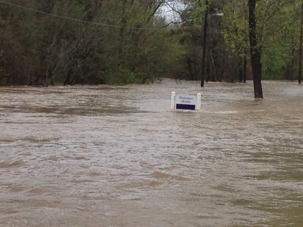 Waters continued to rise late Monday morning in a Pelham mobile home community.