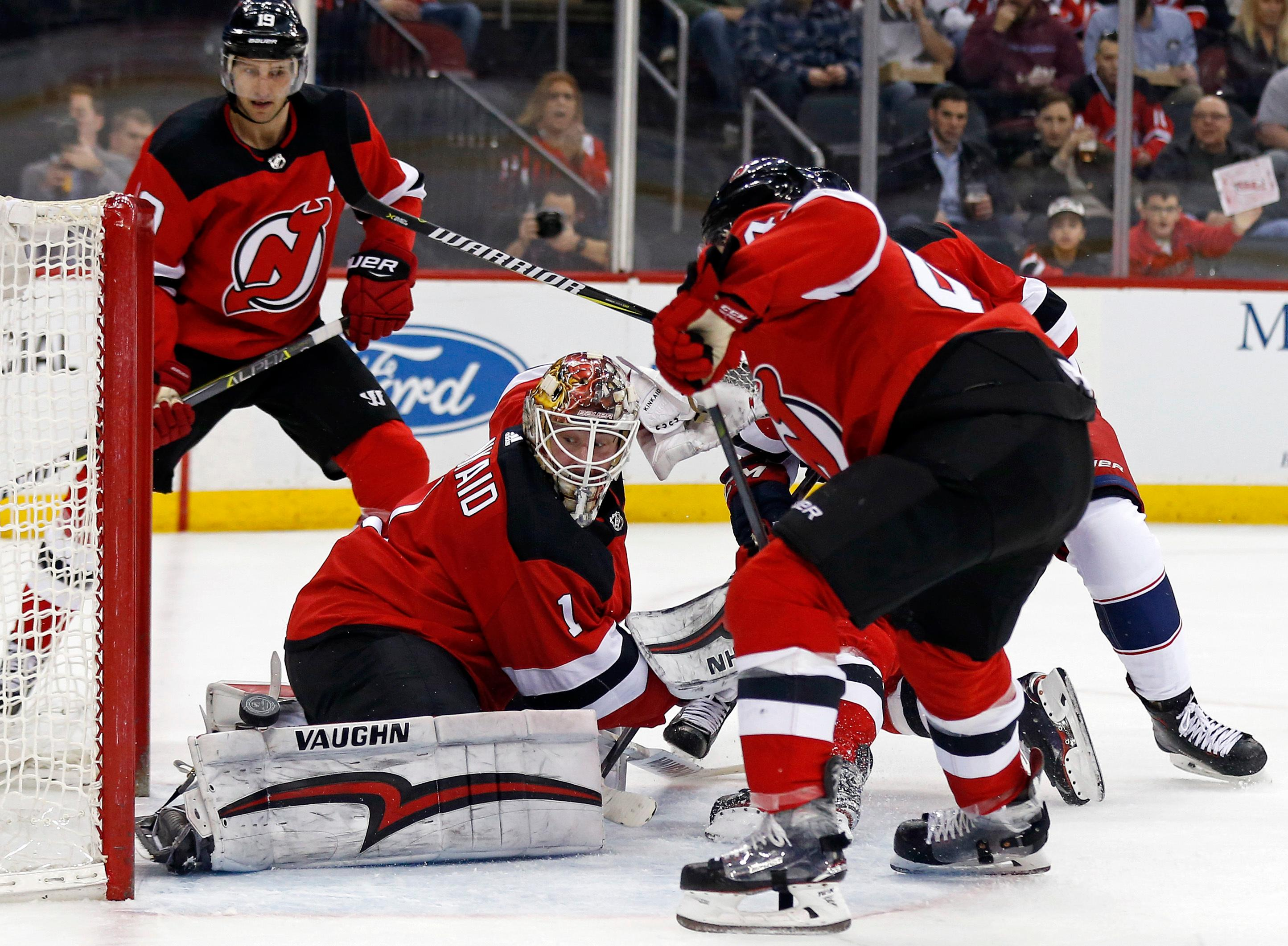 New Jersey Devils goaltender Keith Kinkaid (1) makes a save against the Columbus Blue Jackets during the first period of an NHL hockey game Tuesday, Feb. 20, 2018, in Newark, N.J. (AP Photo/Adam Hunger)