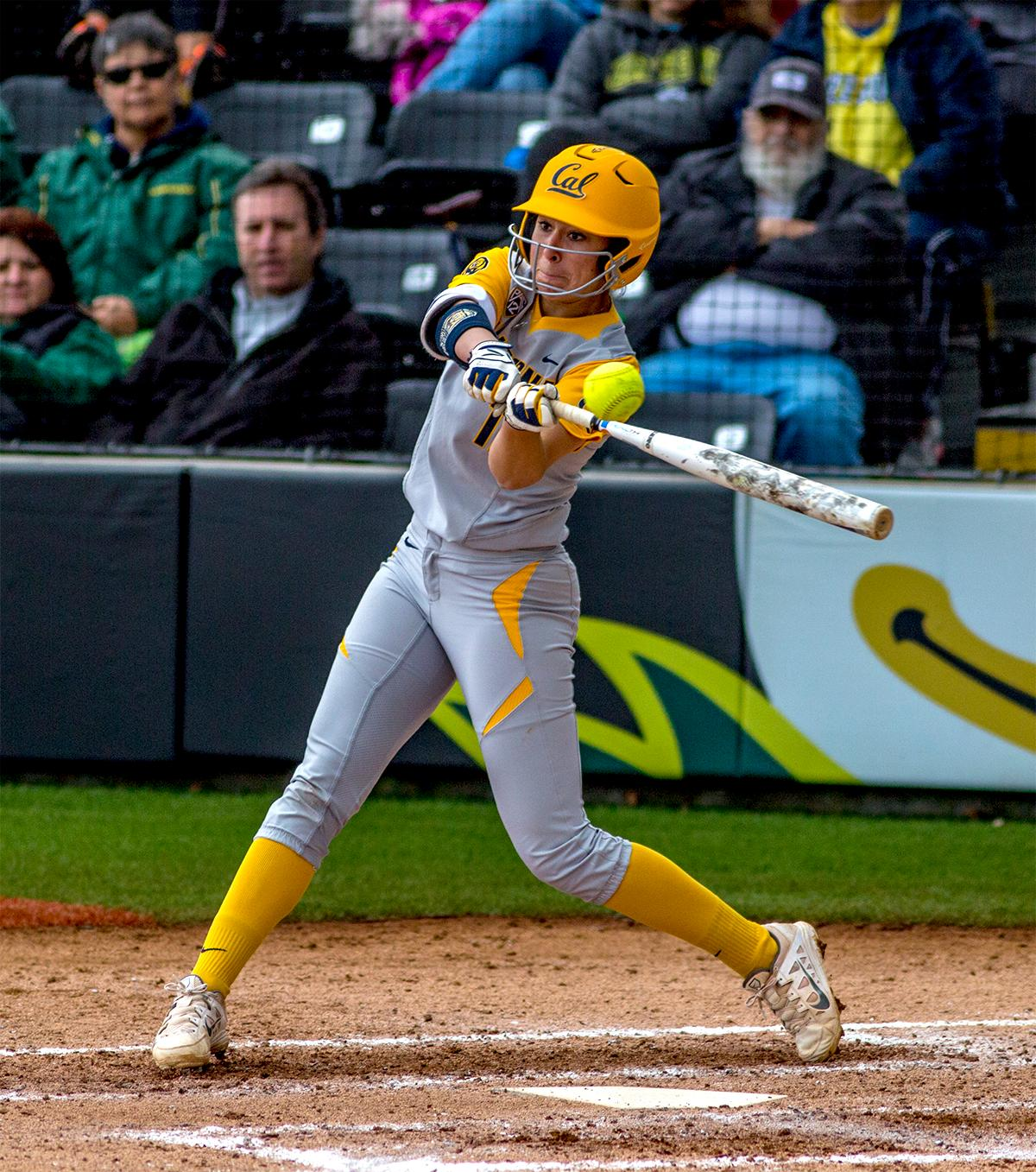 The Golden Bears' Lyndsay Rood (#15) swings for the ball. The Oregon Ducks defeated the Cal Golden Bears 2-1 in the second game of the three game series. Photo by August Frank, Oregon News Lab