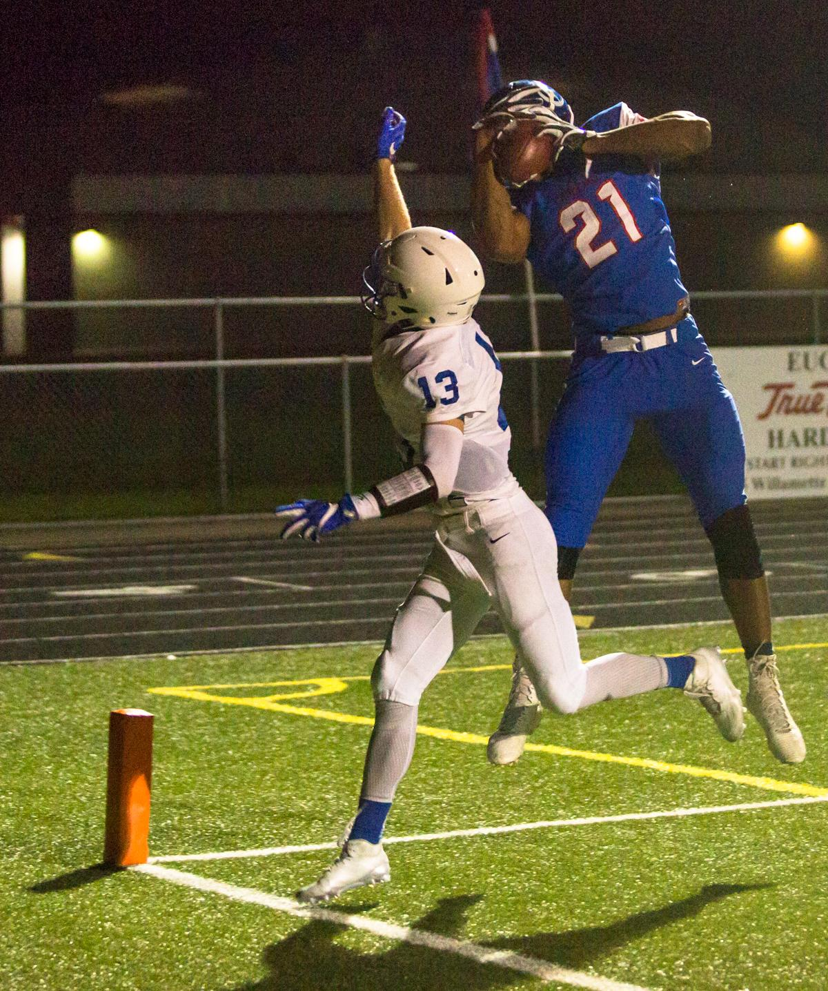Churchill Lancers wide receiver Lucas Wilson (#21) hauls in a long pass. Eagle Point defeated Churchill 42-37. Photo by Justin Hartney, Oregon News Lab