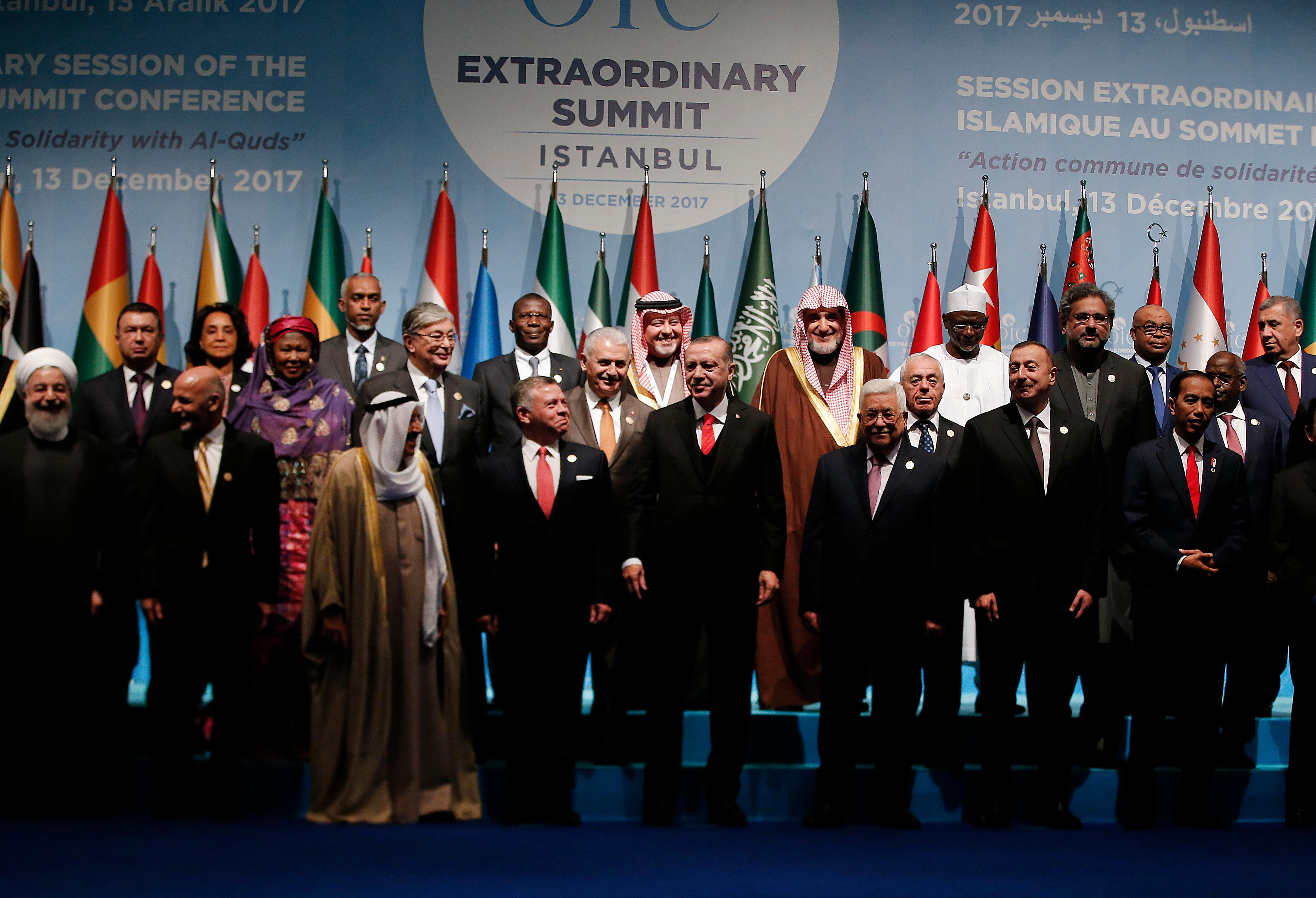Turkey's President Recep Tayyip Erdogan, centre, flanked by Jordan's King Abdullah II, left and Palestinian President Mahmoud Abbas, right, poses with other leaders of Islamic nations following a photo-op prior to the opening session of the Organisation of Islamic Cooperation Extraordinary Summit in Istanbul, Wednesday, Dec. 13, 2017 Leaders and top officials from Islamic nations, members of 57-member Organization of Islamic Cooperation gathered for a summit that is expected to forge a unified stance against U.S. President Donald Trump's recognition of Jerusalem as the capital of Israel. (AP Photo/Lefteris Pitarakis)