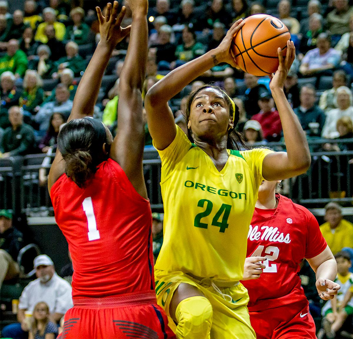 The Duck's Ruthy Hebard (#24) goes up for the shot. The Duck's Sabrina Ionescu (#20) is introduced at the start of the game against the Ole Miss Rebels. The Oregon Ducks womens basketball team defeated the Ole Miss Rebels 90-46 on Sunday at Matthew Knight Arena. Sabrina Ionescu tied the NCAA record for triple-doubles, finishing the game with 21 points, 14 assists, and 11 rebounds. Ruthy Hebard added 16 points, Satou Sabally added 12, and both Lexi Bando and Maite Cazorla scored 10 each. The Ducks will next face off against Texas A&M on Thursday Dec. 21 and Hawaii on Friday Dec. 22 in Las Vegas for Duel in the Desert before the start of Pac-12 games. Photo by August Frank, Oregon News Lab
