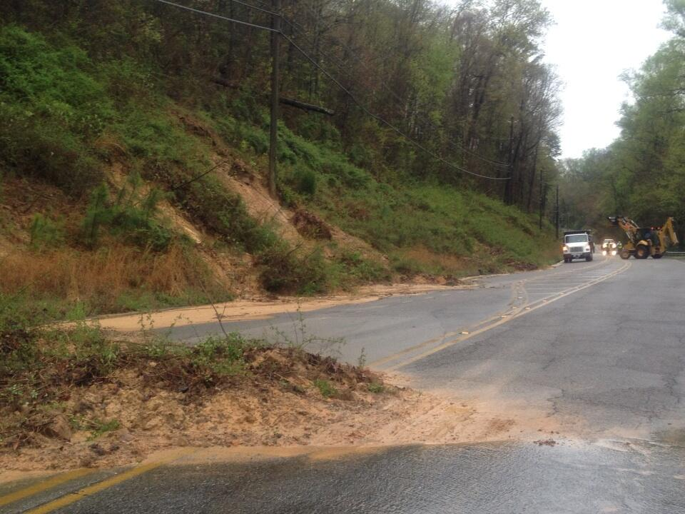 Heavy rain caused a mudslide on Rocky Ridge Road between Hwy. 280 and Tanglewood Drive in Vestavia Hills, Ala., Monday, April 7, 2014.