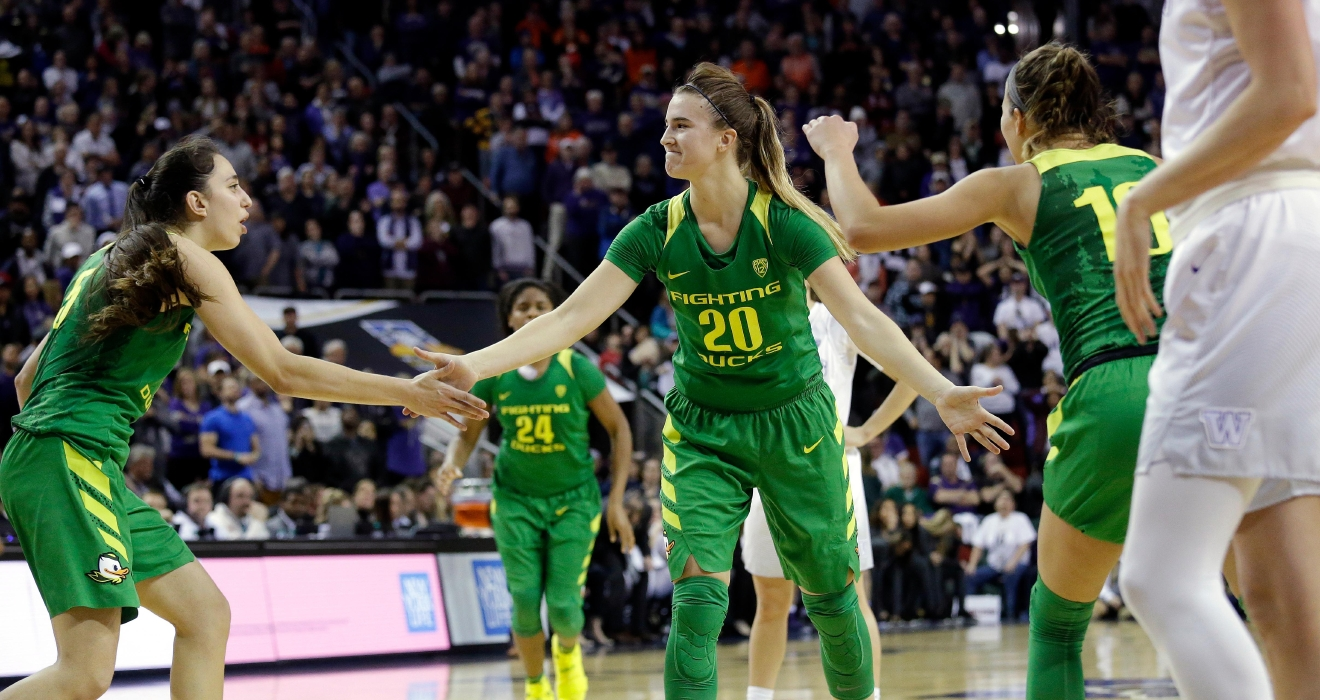 Oregon's Sabrina Ionescu (20) is congratulated by teammates after making the first of two free throws against Washington in the final seconds of an NCAA college basketball game in the Pac-12 tournament, Friday, March 3, 2017, in Seattle. Oregon won 70-69. (AP Photo/Elaine Thompson)