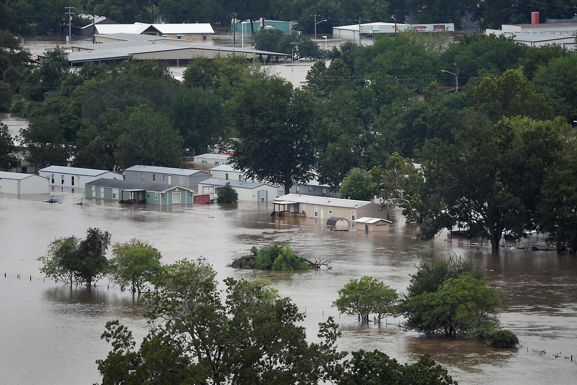 Widespread flooding due to Tropical Storm Harvey is viewed Monday, Aug. 28, 2017, in La Grange, Texas. (Ralph Barrera/Austin American-Statesman via AP)