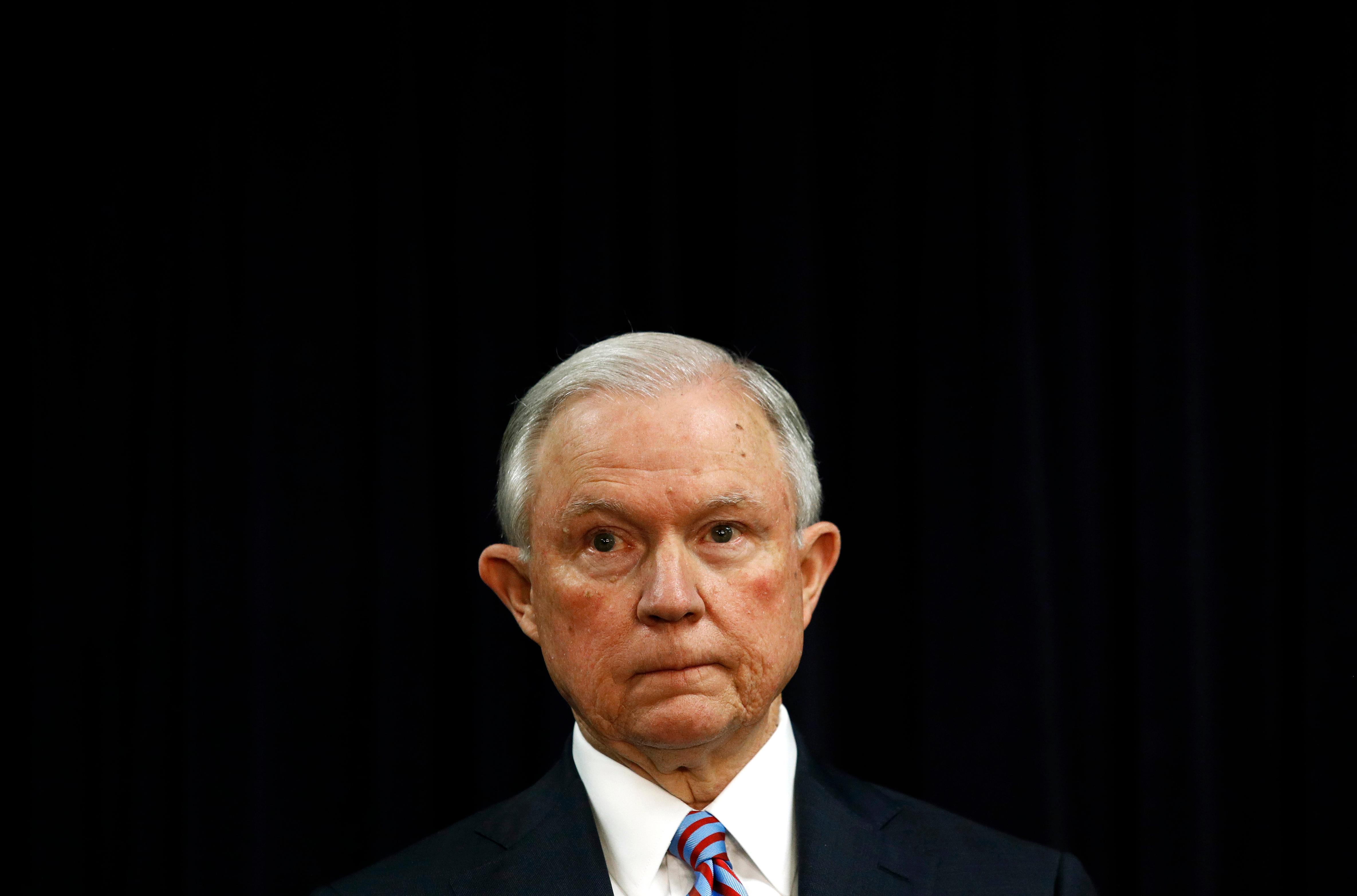 Attorney General Jeff Sessions listens as Secretary of Homeland Security Kirstjen Nielsen speaks during a news conference in Baltimore, Tuesday, Dec. 12, 2017, to announce efforts to combat the MS-13 street gang with law enforcement and immigration actions. (AP Photo/Patrick Semansky)