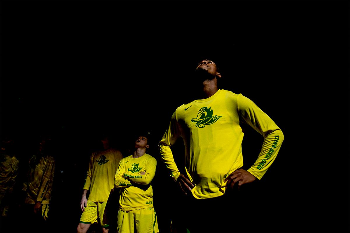 The Ducks await for their names to be announced before the start of the game. The Oregon Ducks defeated the Colorado Buffaloes 77-62 at Matthew Knight Arena on Sunday. Troy Brown had a season-high score of 21 points, Elijah Brown added 17, while Kenny Wooten and Payton Pritchard added 13 and 12 respectively. Oregon is now 1-1 in conference play. The Ducks next face off against the Oregon State Beavers in Corvallis on Friday, January 5th. Photo by August Frank, Oregon News Lab