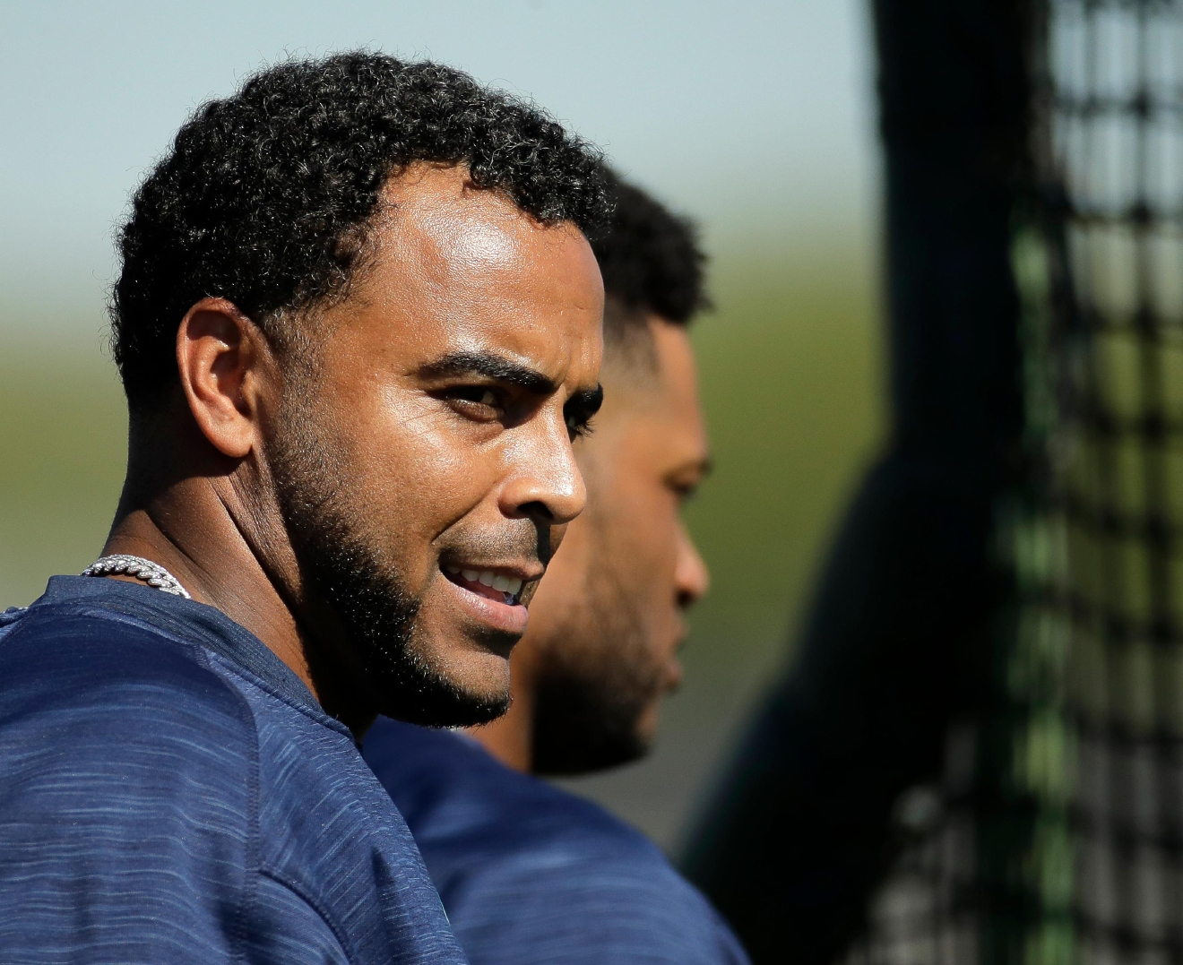 Seattle Mariners' Nelson Cruz, left, and Robinson Cano watch a drill during spring training baseball practice, Tuesday, Feb. 21, 2017, in Peoria, Ariz. (AP Photo/Charlie Riedel)