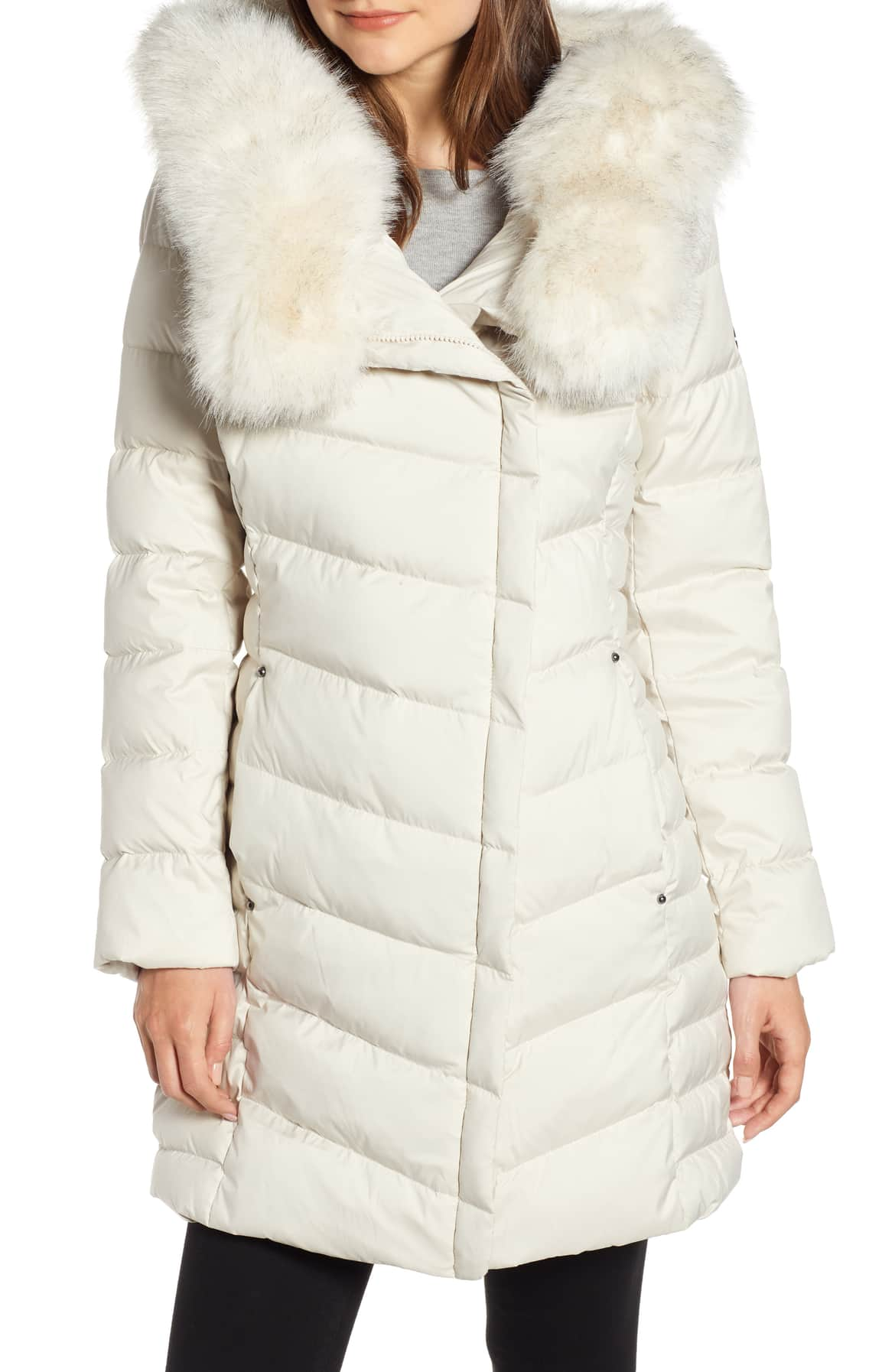 <p>A supersized ruff of soft faux fur trims the hood and neckline of a channel-quilted puffer jacket.{&nbsp;}$238.00 (Image: Nordstrom){&nbsp;}</p><p></p>