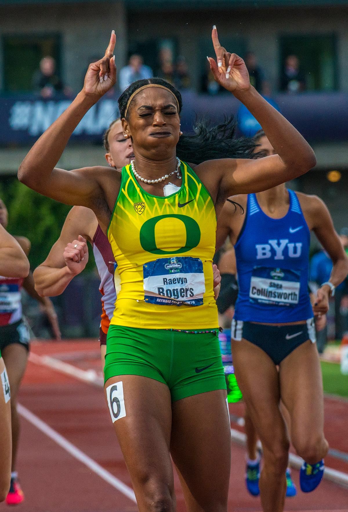 "Raevyn Rogers, University of Oregon, celebrates her victory of the Women's 800m Final. She won the event with a time of 2:00.02 on day four of the NCAA Division I Outdoor Track and Field Championship at Hayward Field. The University of Oregon Women's Track team set a new collegiate best of 3:23.13 in the 4x400 Relay to clinch the overall win with a cumulative score of 64 points in the NCAA Division I Outdoor Track and Field Championship, as well as becoming the first school to ever win the ""Triple Crown"": the National Cross Country, the Indoor Track and Field, and the Outdoor Track and Field all in the same academic year. Georgia came in second overall with 62.2 points and Southern California took third place with 43 points. Photo by Rhianna Gelhart, Oregon News Lab"