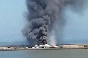 This photo provided by Antonette Edwards shows what a federal aviation official says was an Asiana Airlines flight crashing while landing at San Francisco airport on Saturday. (AP Photo/Antonette Edwards)