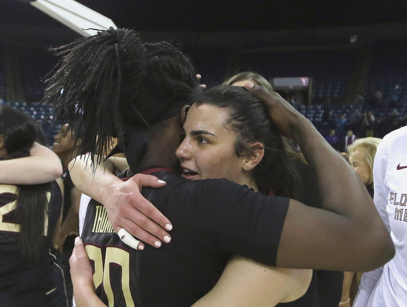 Florida State guard Leticia Romero, right, hugs teammate Shakayla Thomas after beating Oregon State 66-53 in a regional semi-final round game of an NCAA college basketball tournament, Saturday, March 25, 2017, in Stockton, Calif. (AP Photo/Rich Pedroncelli)