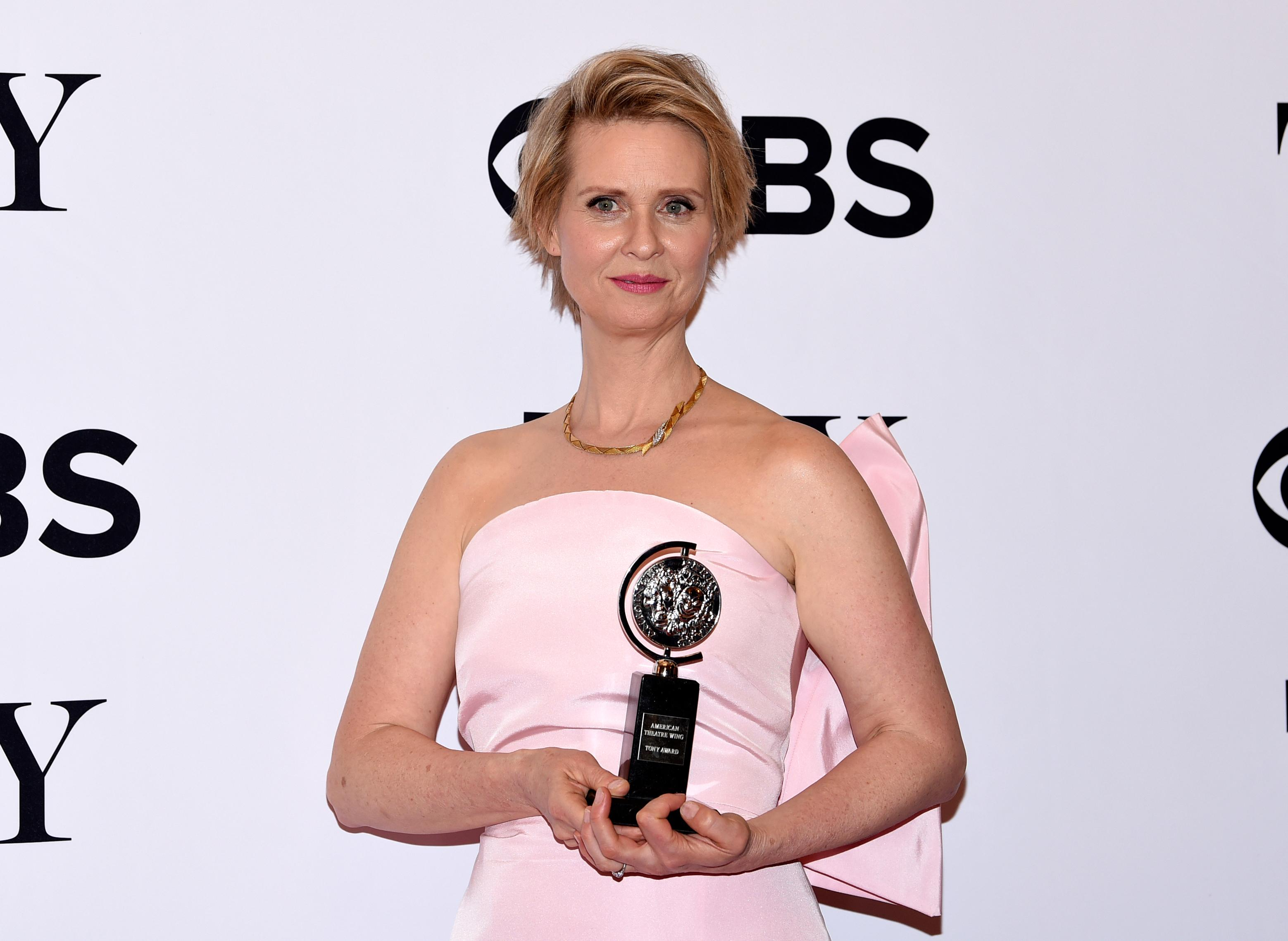 "Cynthia Nixon poses in the press room with the award for best performance by an actress in a featured role in a play for ""Lillian Hellman's The Little Foxes"" at the 71st annual Tony Awards on Sunday, June 11, 2017, in New York. (Photo by Evan Agostini/Invision/AP)"