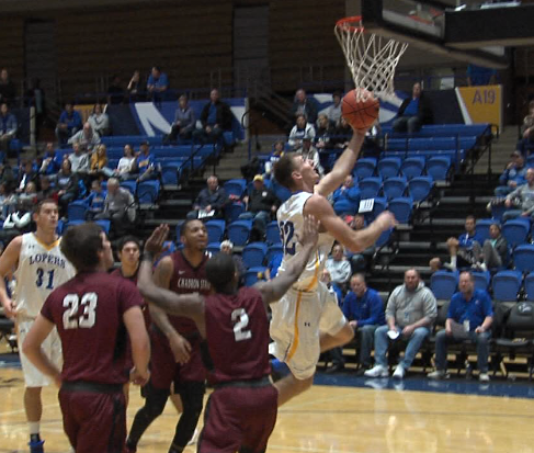 Kyle Juhl (32), a sophomore at UNK, goes up with his left hand and scores against Chadron State on Nov. 15, 2017 (KHGI)<p></p>