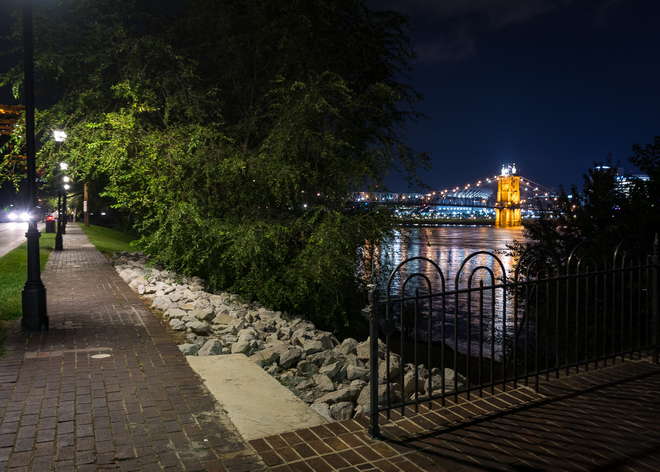There is perhaps no better time to take an evening walk along Riverside Drive in Covington than now. Between the cooling temperatures that haven't yet shaken the leaves from the trees and the temporary SkyStar Ferris wheel across the river that's lighting up Smale Park, the next few weeks will offer peak comfort and beautiful views for anyone who visits. / Image: Phil Armstrong, Cincinnati Refined // Published: 9.24.18{ }