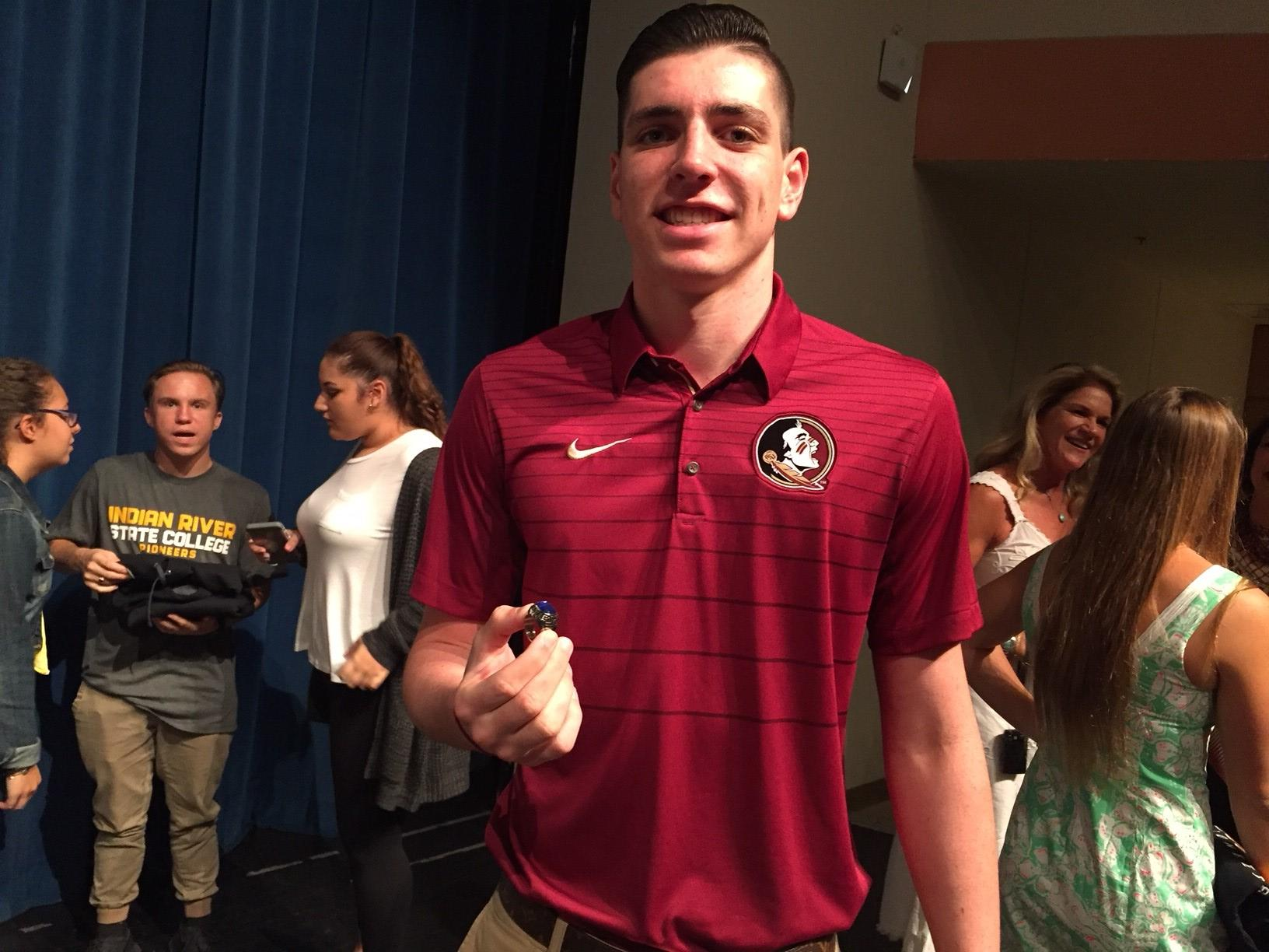 Park Vista swimmer Kyle DiMatteo shows off his state championship ring.