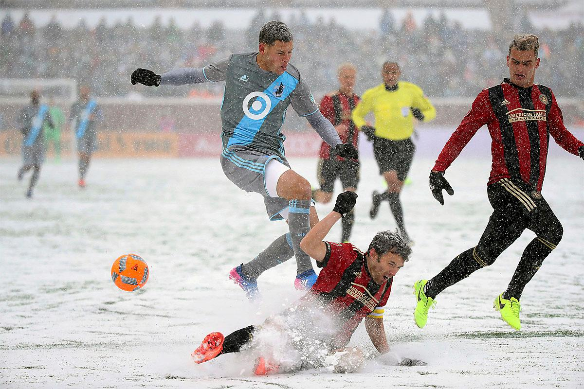 Minnesota United forward Christian Ramirez, center top, and Atlanta United defender Michael Parkhurst battle for the ball in the snow during the first half of an MLS soccer game Sunday, March 12, 2017, in Minneapolis, Minn. (Elizabeth Flores/Star Tribune via AP)