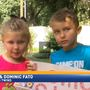 Twins hold lemonade stand to raise money for flood victims
