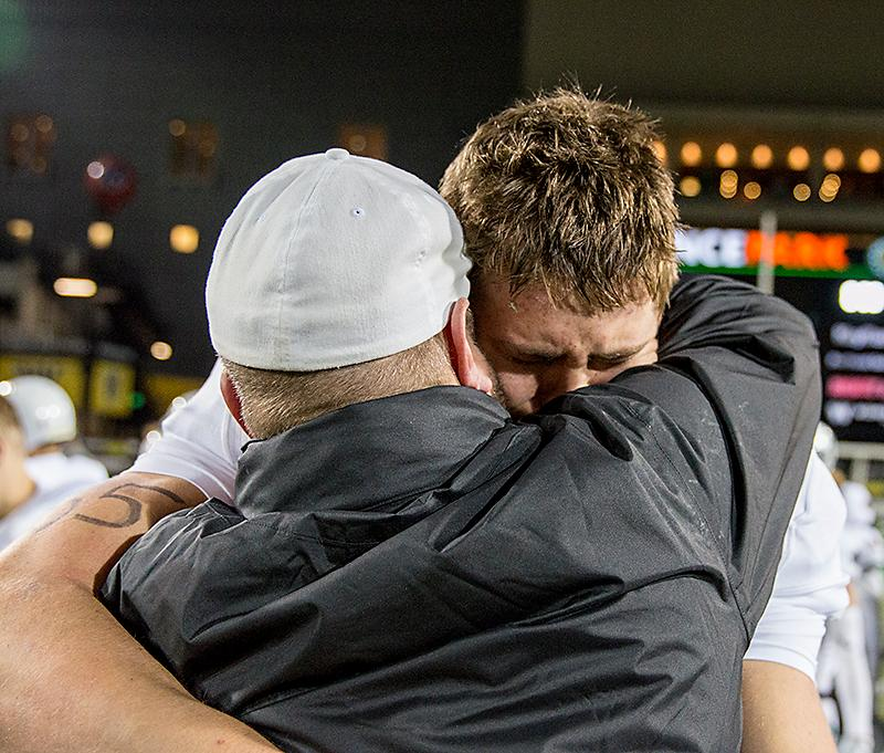 Sheldon senior quarterback Justin Herbert embrace head coach Lane Johnson after the game. With a 34-13 win over Sheldon, Jesuit advances to the OSAA 6A Football State Championship versus West Linn.