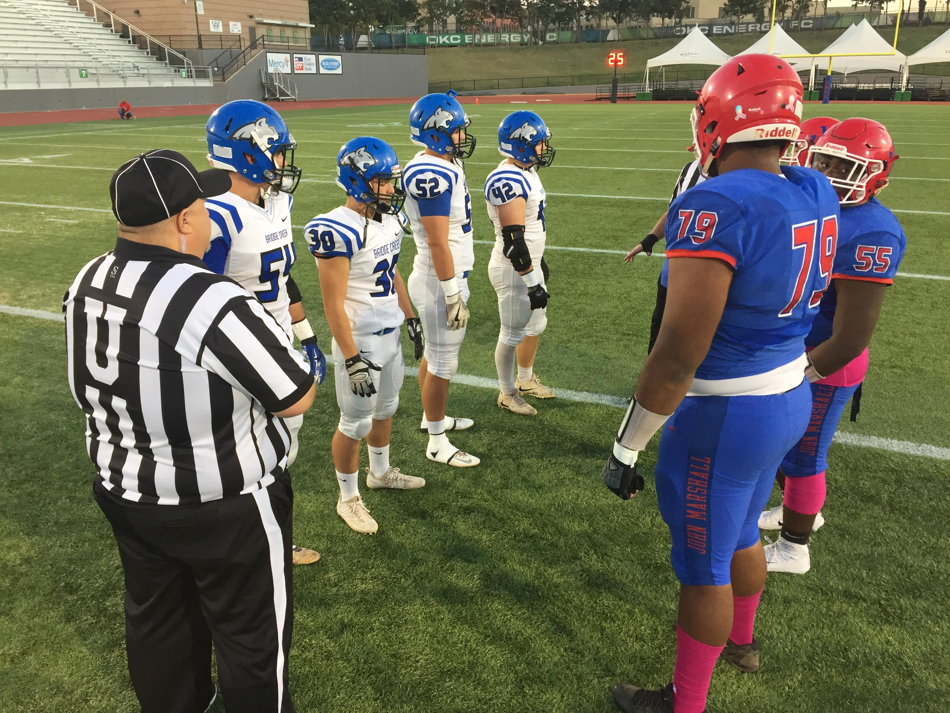 Players from the Bridge Creek Bobcats and John Marshall Bears meet on the field for the coin toss prior to their game during week 7 of high school football on Friday, October 13, 2017. (David Young / KOKH)<p></p>