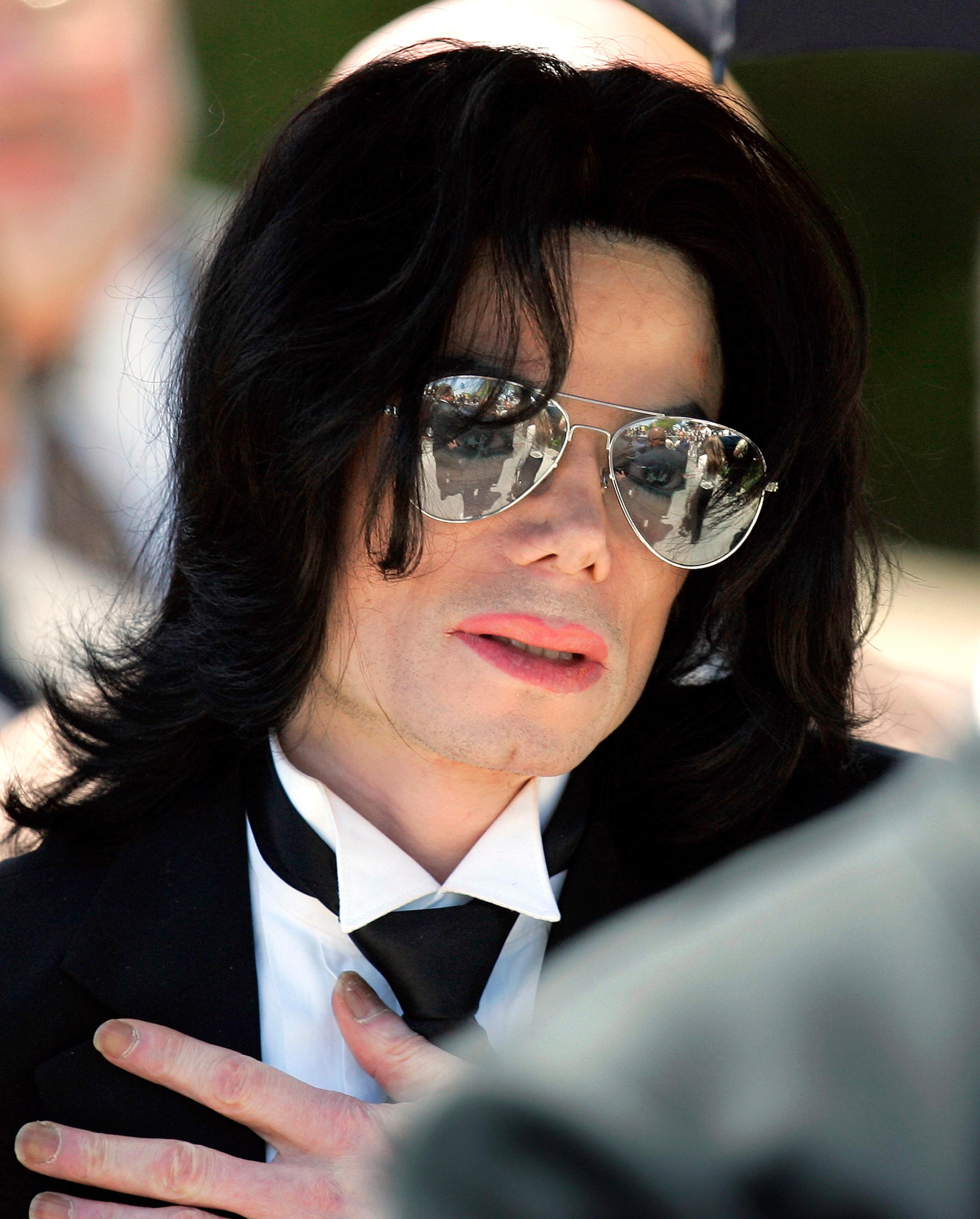 FILE - In this June 13, 2005 photo, Michael Jackson gestures as he leaves court during his trial on child molestation charges in Santa Maria, Calif. Wade Robson, who is now 35, testified at Jackson's criminal trial in 2005 that he had spent many nights in Jackson's room, but Jackson had never molested him. A judge has dismissed the lawsuit brought by Robson, who alleged Jackson molested him as a child. The summary judgment ruling Tuesday, Dec. 19, 2017, against Robson resolves one of the last remaining major claims against the late singer's holdings. (AP Photo/Mark J. Terrill, File)