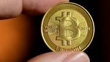 Bitcoin's unprecedented rise leaves financial world divided on future of digital currency