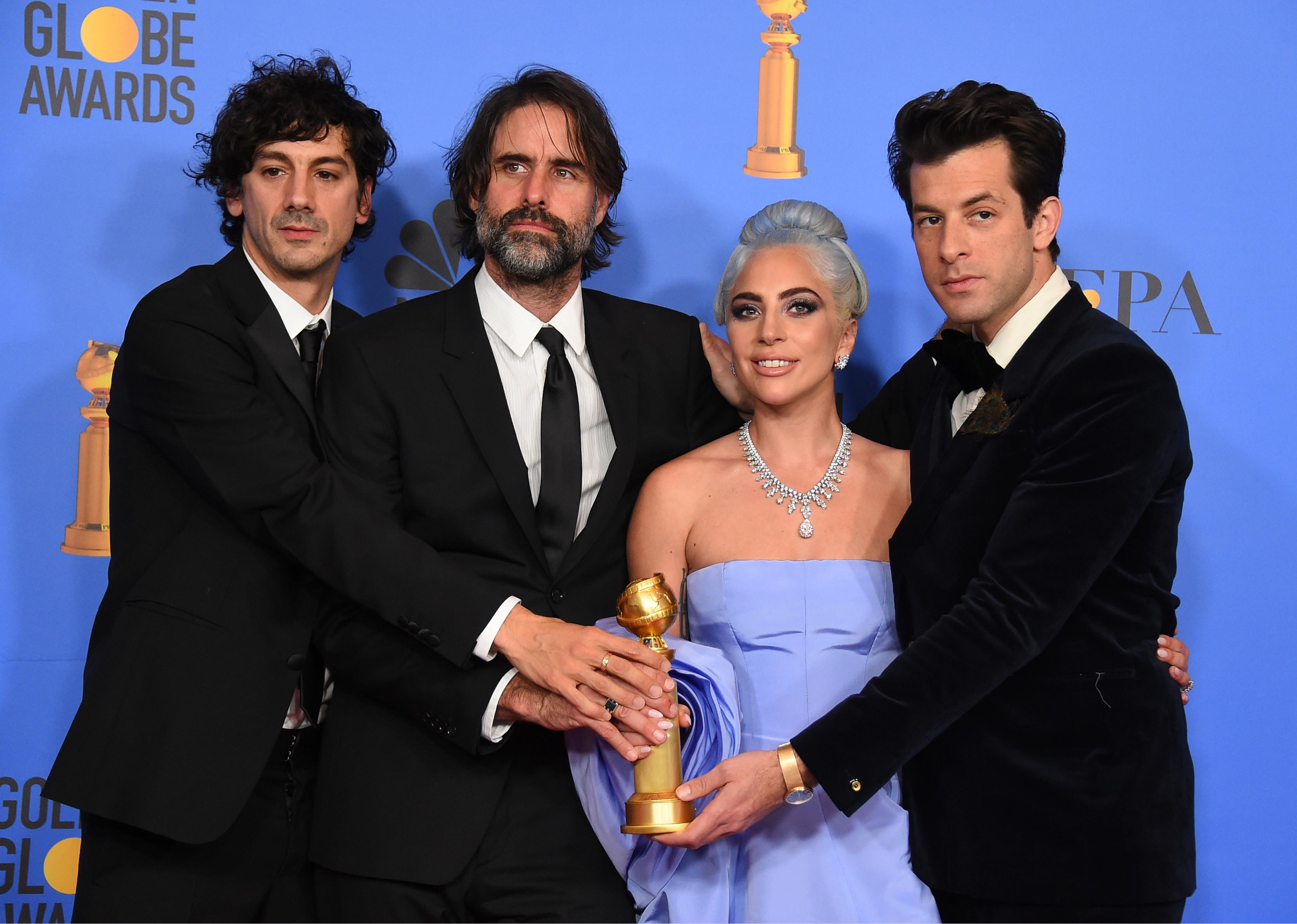 "Anthony Rossomando, from left, Andrew Wyatt, Lady Gaga and Mark Ronson pose in the press room with the award for best original song, motion picture for ""Shallow"" from the film ""A Star Is Born"" at the 76th annual Golden Globe Awards at the Beverly Hilton Hotel on Sunday, Jan. 6, 2019, in Beverly Hills, Calif. (Photo by Jordan Strauss/Invision/AP)"