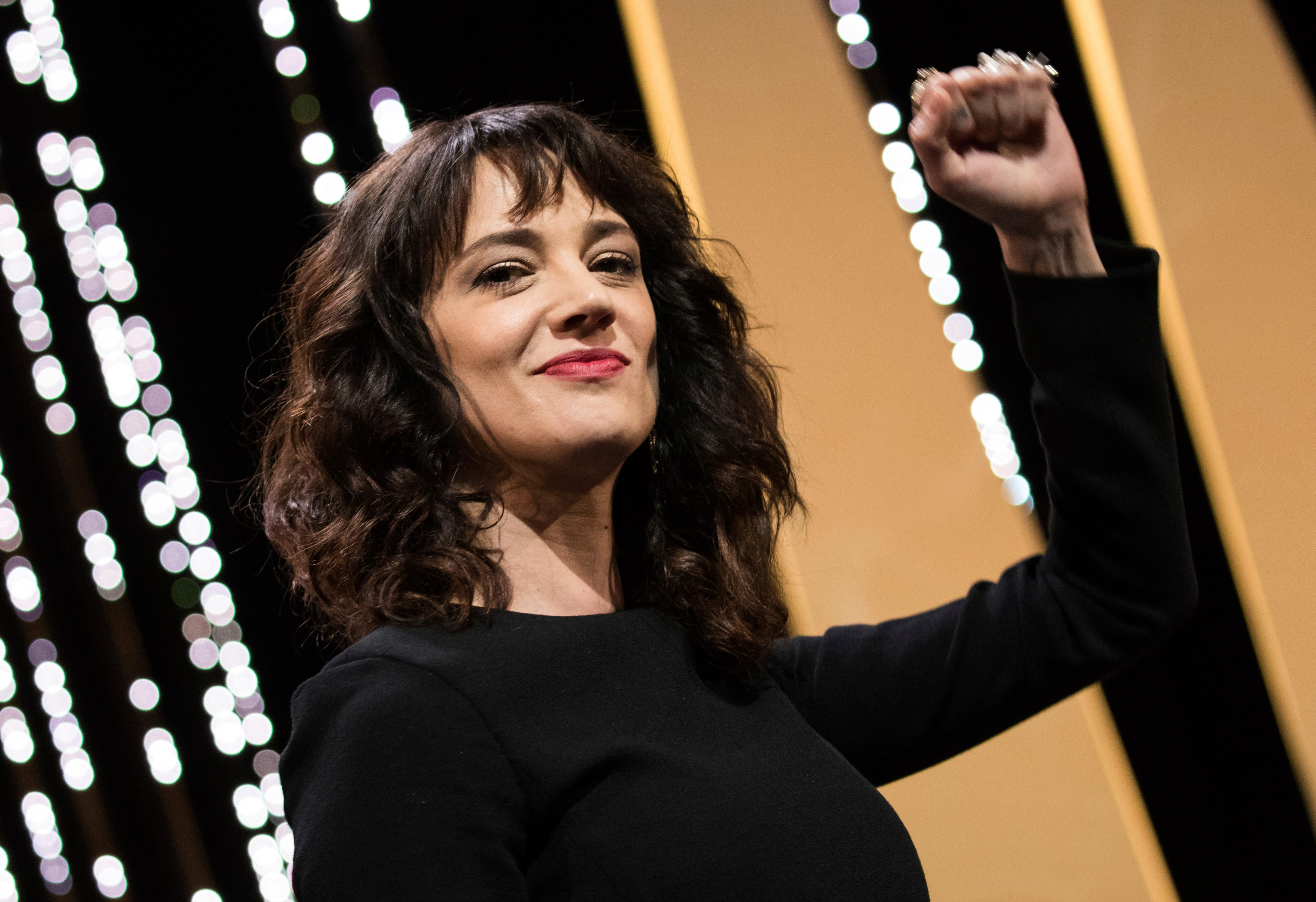 FILE - In this May 19, 2018 file photo, actress Asia Argento gestures during the closing ceremony of the 71st international film festival in Cannes, France. Argento, one of the most prominent activists of the #MeToo movement against sexual harassment, recently settled a complaint filed against her by a young actor and musician who said she sexually assaulted him when he was 17, the New York Times reported. (Vianney Le Caer/Invision/AP, FIle)