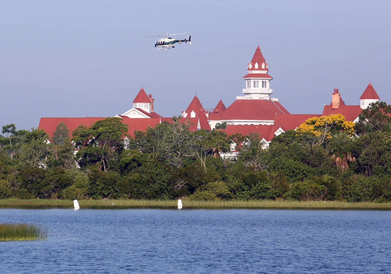 An Orange County Sheriffs helicopter searches for a young boy early Wednesday, June 15, 2016, after the boy was dragged into the water Tuesday night by an alligator near Disney's upscale Grand Floridian Resort & Spa in Lake Buena Vista, Fla. (Red Huber/Orlando Sentinel via AP) MAGS OUT; NO SALES; MANDATORY CREDIT