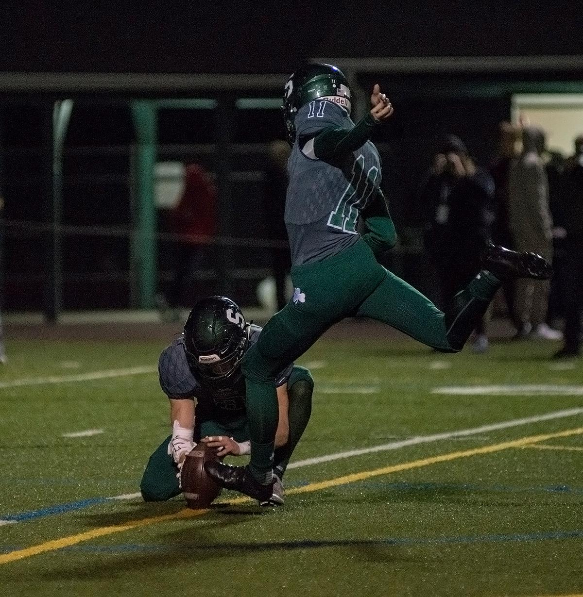 Sheldon Irish kicker Campbell Sheidow (#11) winds up for the extra point after an Irish touchdown. The Sheldon Irish defeated the Beaverton Beavers 48-7 on Friday night at Sheldon in the first round of 6A state playoffs. Photo by Abigail Winn, Oregon News Lab