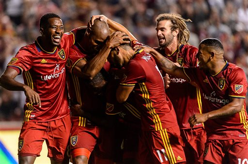 Real Salt Lake players swarm on defender Jamison Olave (4) after his goal against FC Dallas during an MLS soccer match in Sandy, Utah, Saturday, Aug. 20, 2016. (Trent Nelson/The Salt Lake Tribune via AP)