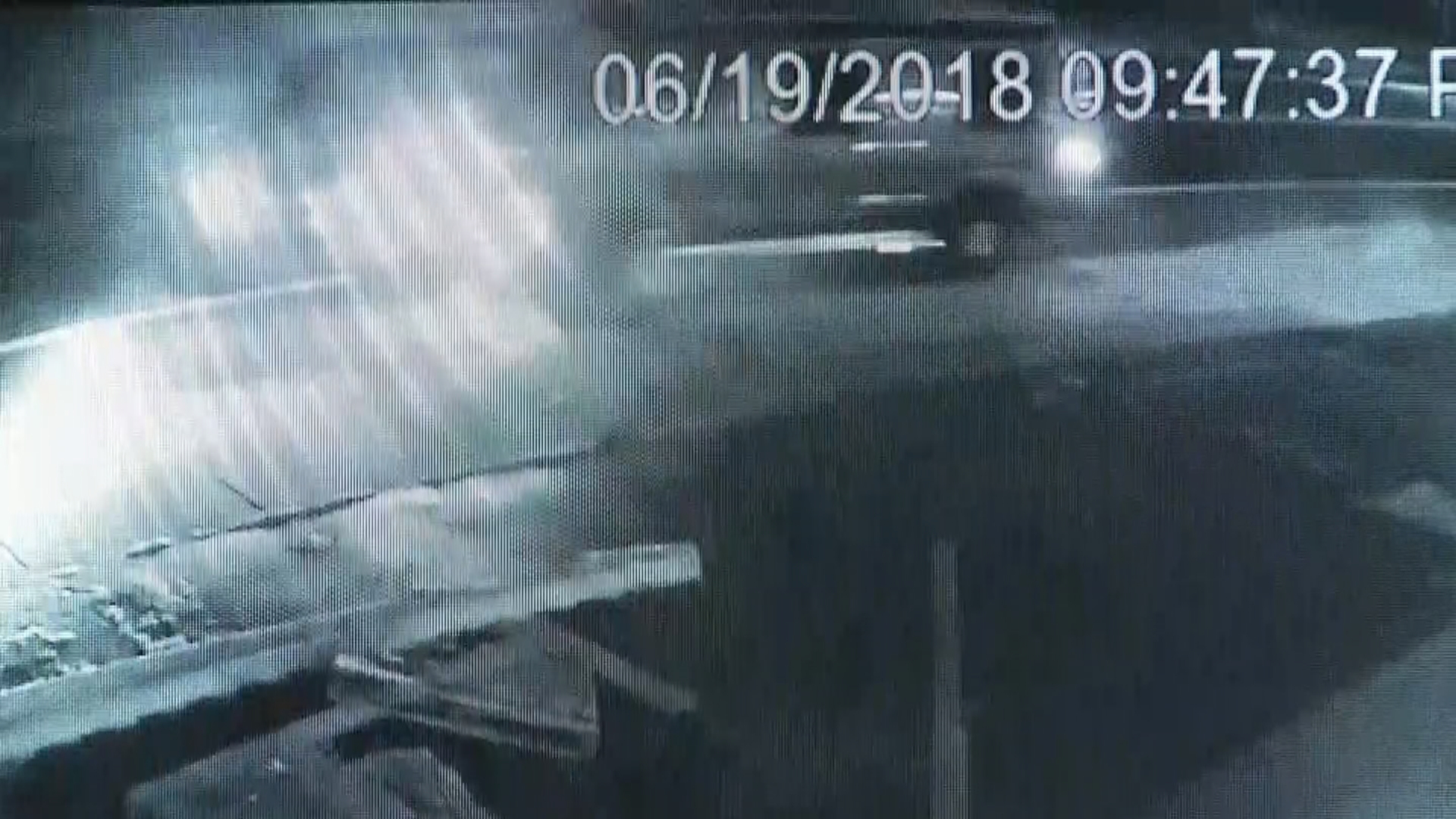 Exclusive video obtained by NBC 10 News shows a car slowing down as a van approaches it head-on. The van crashes into the car, pushing it off the road and into a driveway.