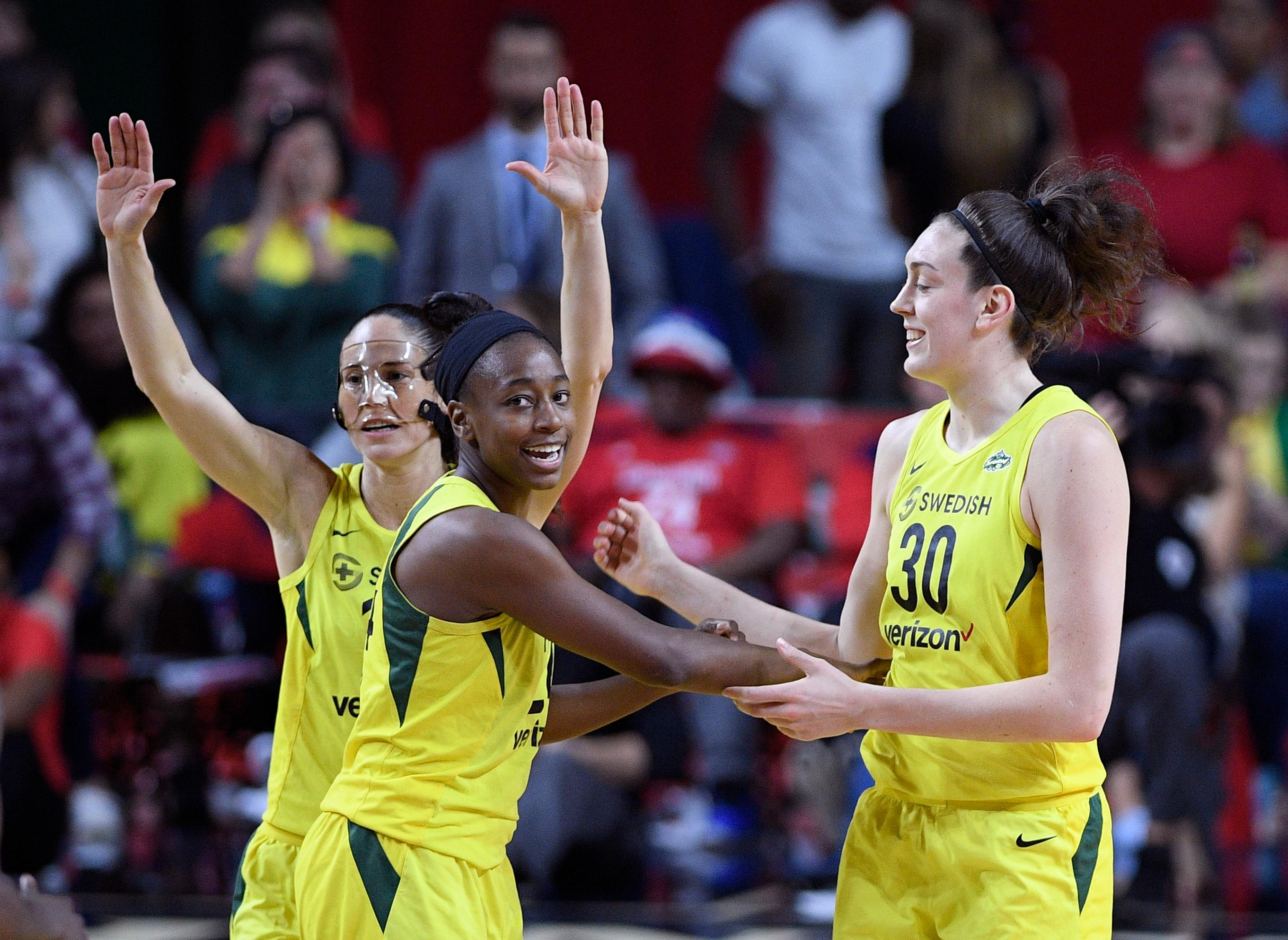 Seattle Storm guard Sue Bird, back left, Jewell Loyd, center, and Breanna Stewart (30) react during the first half of Game 3 of the WNBA basketball finals against the Washington Mystics, Wednesday, Sept. 12, 2018, in Fairfax, Va. (AP Photo/Nick Wass)