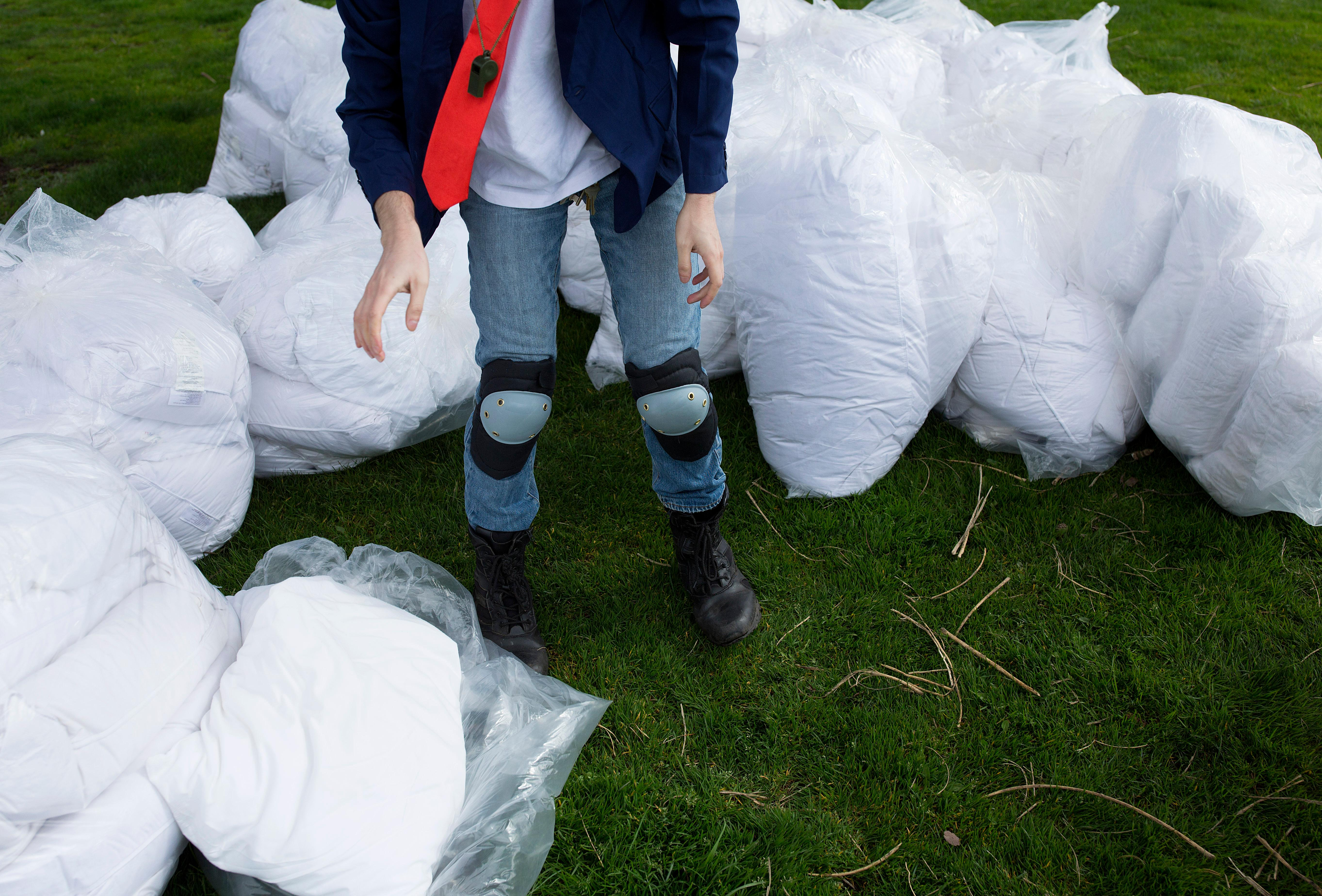 A massive pillow fight broke out at Cal Anderson Park on Capitol Hill for International Pillow Fight Day. Pillows were donated by a local hotel, and cash donations by participants will go to local homeless shelters, Compass Housing Alliance and DESC. (Sy Bean / Seattle Refined)
