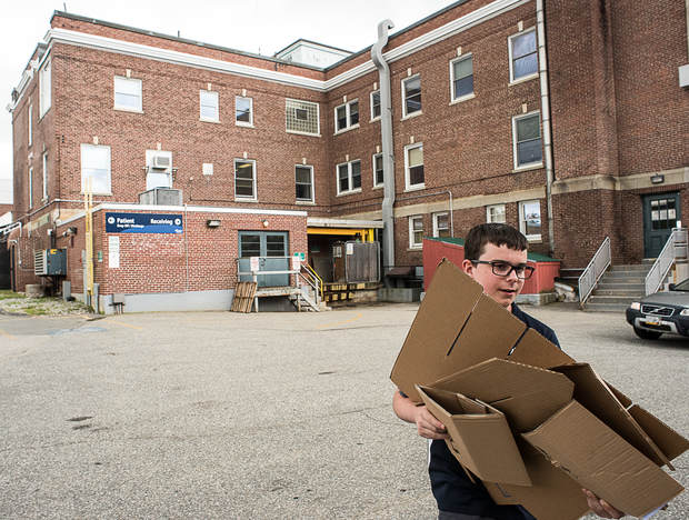 One of the duties Colby Volkernick has while volunteering at the Rumford Hospital is breaking down cardboard boxes and bringing them to the recycling pile. Volkernick volunteers at the hospital three days a week. (CTSY: Andree Kehn, Sun Journal)