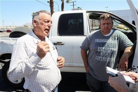 Embattled Bunkerville rancher Cliven Bundy, left, and his son Dave Bundy talk to a reporter on the corner of North Las Vegas Boulevard and East Stewart Avenue in downtown Las Vegas Monday, April 7, 2014.