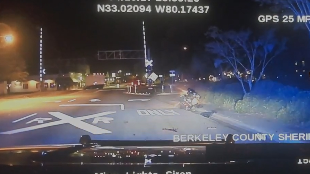 Dash camera video provided by the Berkeley County Sheriff's Office shows one of its deputies hit a motorcycle driver with his cruiser during a high-speed chase. Moments later, the driver wrecked and was killed. (BCSO)