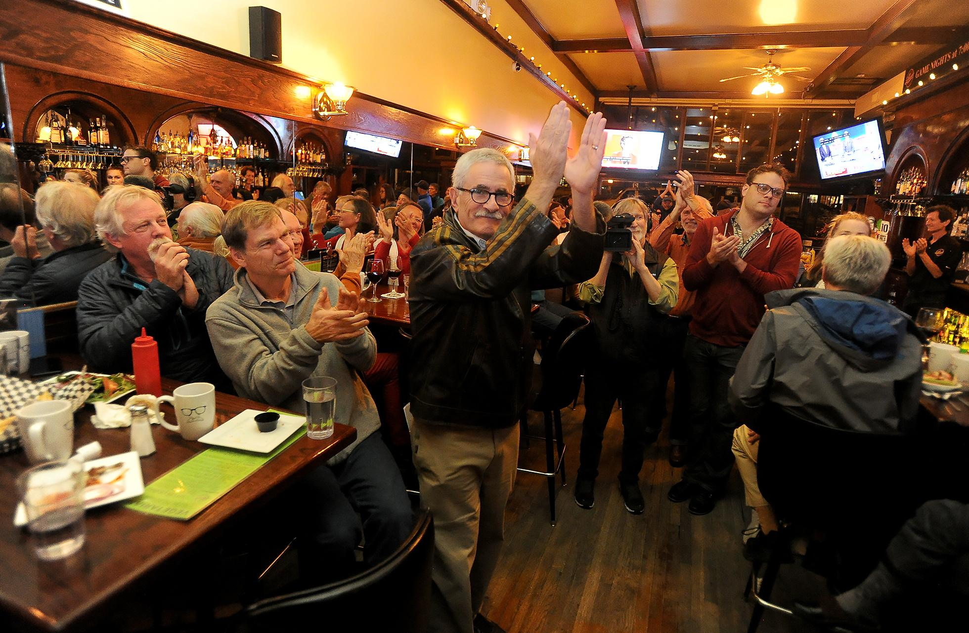 "Jeff Golden raises his hands in ""thanks"" to a crowd of supporters gathered Tuesday night at Louie's Restaurant in Ashland. Photo by Denise Baratta"