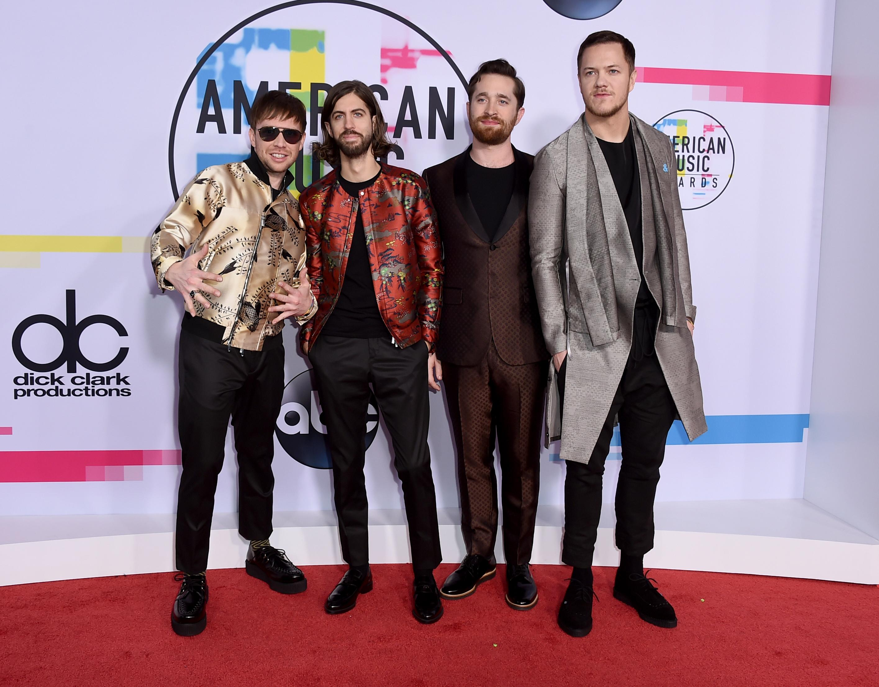 Ben McKee, from left, Daniel Wayne Sermon, Daniel Platzman, and Dan Reynolds of Imagine Dragons arrive at the American Music Awards at the Microsoft Theater on Sunday, Nov. 19, 2017, in Los Angeles. (Photo by Jordan Strauss/Invision/AP)