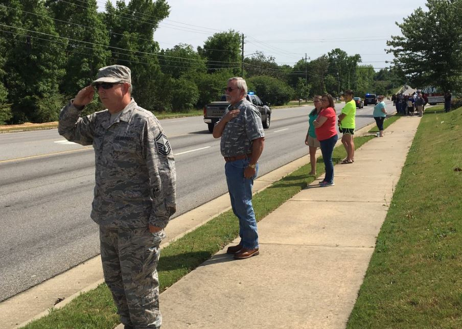 "People lined the streets of Macon Monday afternoon to show respect for fallen Bibb deputy investigator Anthony ""TJ"" Freeman / Molly Wilkins (WGXA)"