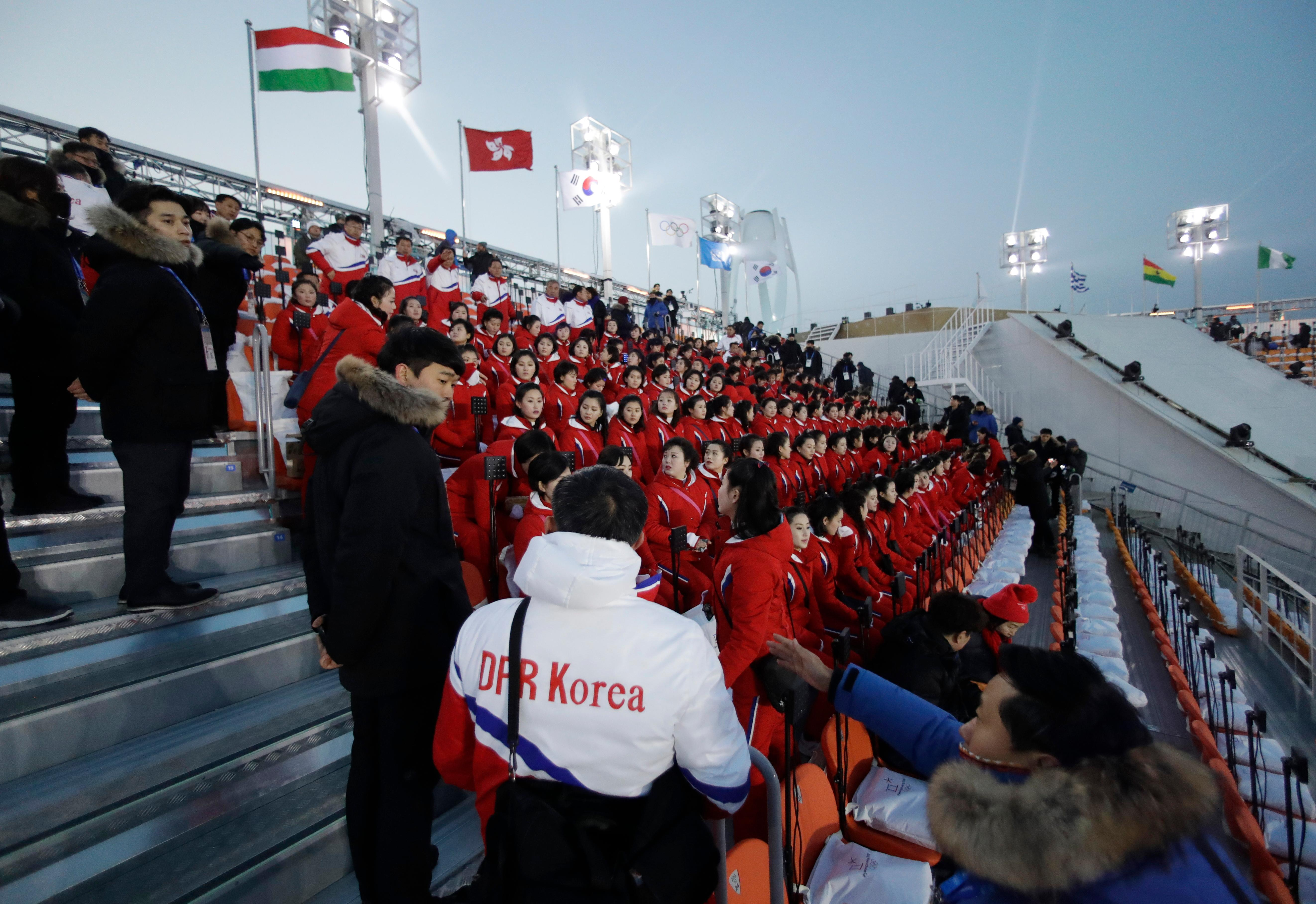 Members of the North Korean delegation sit before the opening ceremony of the 2018 Winter Olympics in Pyeongchang, South Korea, Friday, Feb. 9, 2018. (AP Photo/Matthias Schrader)
