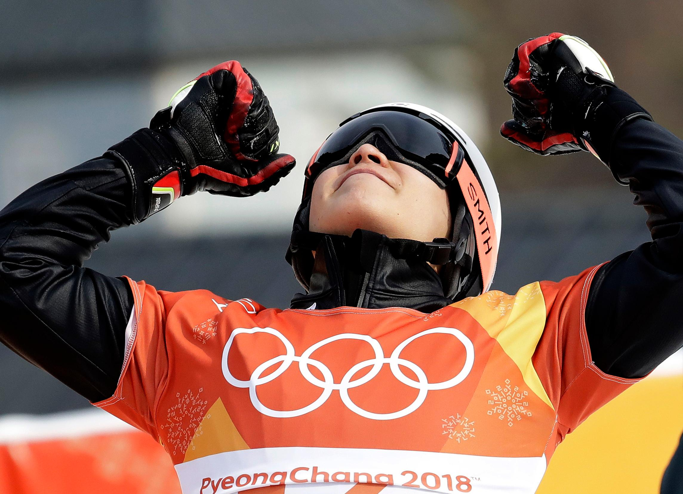 Silver medal winner Lee Sangho, of South Korea, celebrates after competing in the men's parallel giant slalom semifinal at Phoenix Snow Park at the 2018 Winter Olympics in Pyeongchang, South Korea, Saturday, Feb. 24, 2018. (AP Photo/Lee Jin-man)