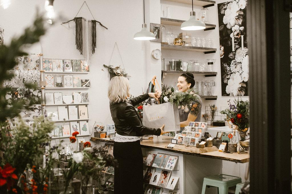 Fleurae Floralis packed with fresh flowers, bouquets to go, handmade wreaths, candles, antique pillows, and local artisan gifts. (PHOTO: OLYSOCIAL and Poppi Photography).