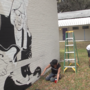 Tom Petty mural painted at his former school, Sidney Lanier