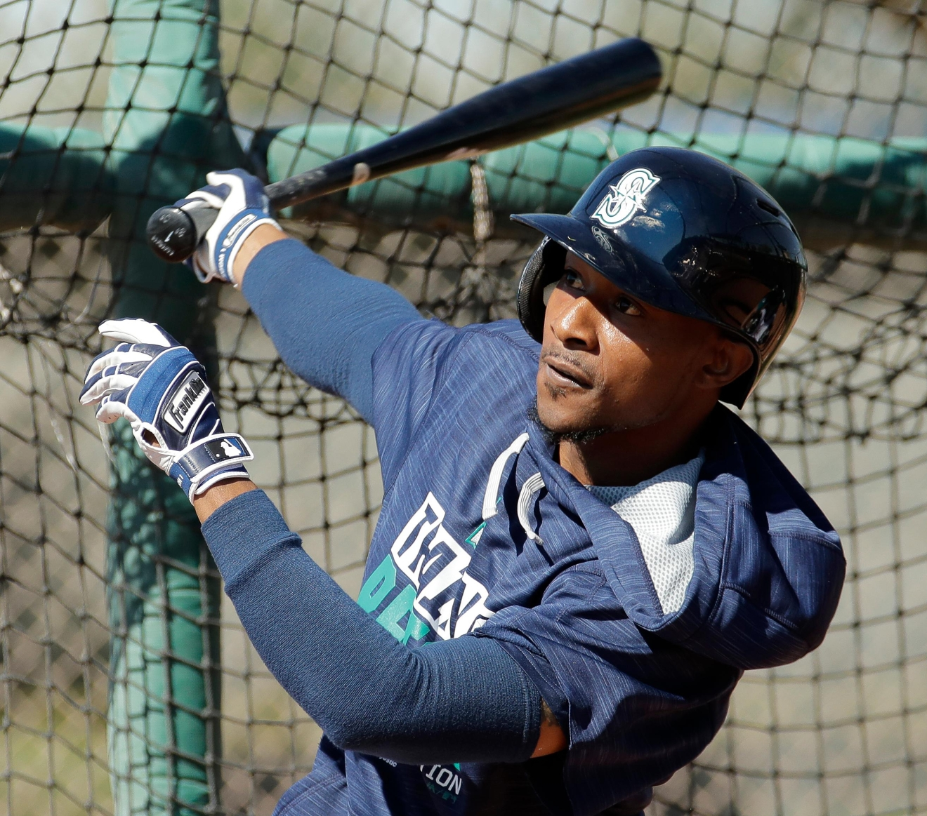 Seattle Mariners' Jarrod Dyson bats during baseball spring training Tuesday, Feb. 21, 2017, in Peoria, Ariz. (AP Photo/Charlie Riedel)