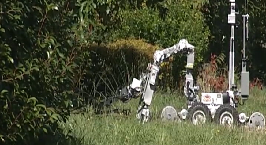 The device fell in the grass during the handoff. The robot reached down and retrieved the device. (SBG)<p></p>
