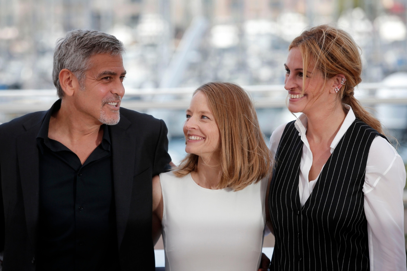 Director Jodie Foster, centre poses for photographers with actor George Clooney, left and actress Julia Roberts, during a photo call for the film Money Monster at the 69th international film festival, Cannes, southern France, Thursday, May 12, 2016. (AP Photo/Thibault Camus)