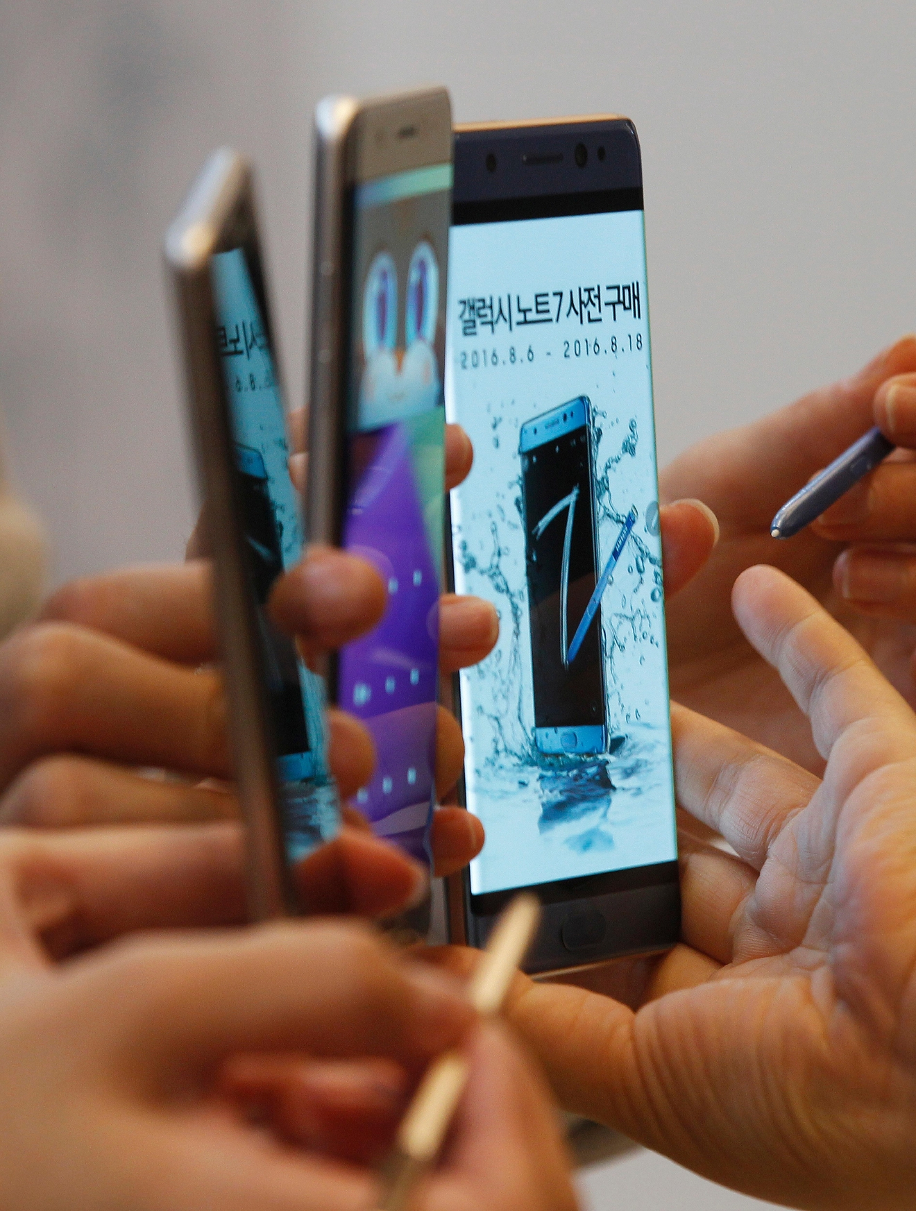 FILE - In this Thursday, Aug. 11, 2016, file photo, models hold Samsung Galaxy Note 7 smartphones during a launch event at the company's headquarters in Seoul, South Korea. In a statement issued Friday, Sept. 9, 2016, the U.S.  Consumer Product Safety Commission said owners of the Galaxy Note 7 smartphones should turn them off and stop using them because of the risk that their batteries can explode. (AP Photo/Ahn Young-joon, File)