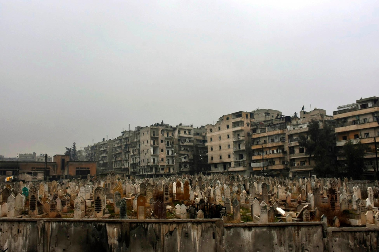 This photo released by the Syrian official news agency SANA, shows a graveyard in east Aleppo, Syria, Tuesday, Dec. 13, 2016. Syrian rebels said Tuesday that they reached a cease-fire deal with Moscow to evacuate civilians and fighters from eastern Aleppo, after the U.N. and opposition activists reported possible mass killings by government forces closing in on the rebels' last enclave. (SANA via AP)