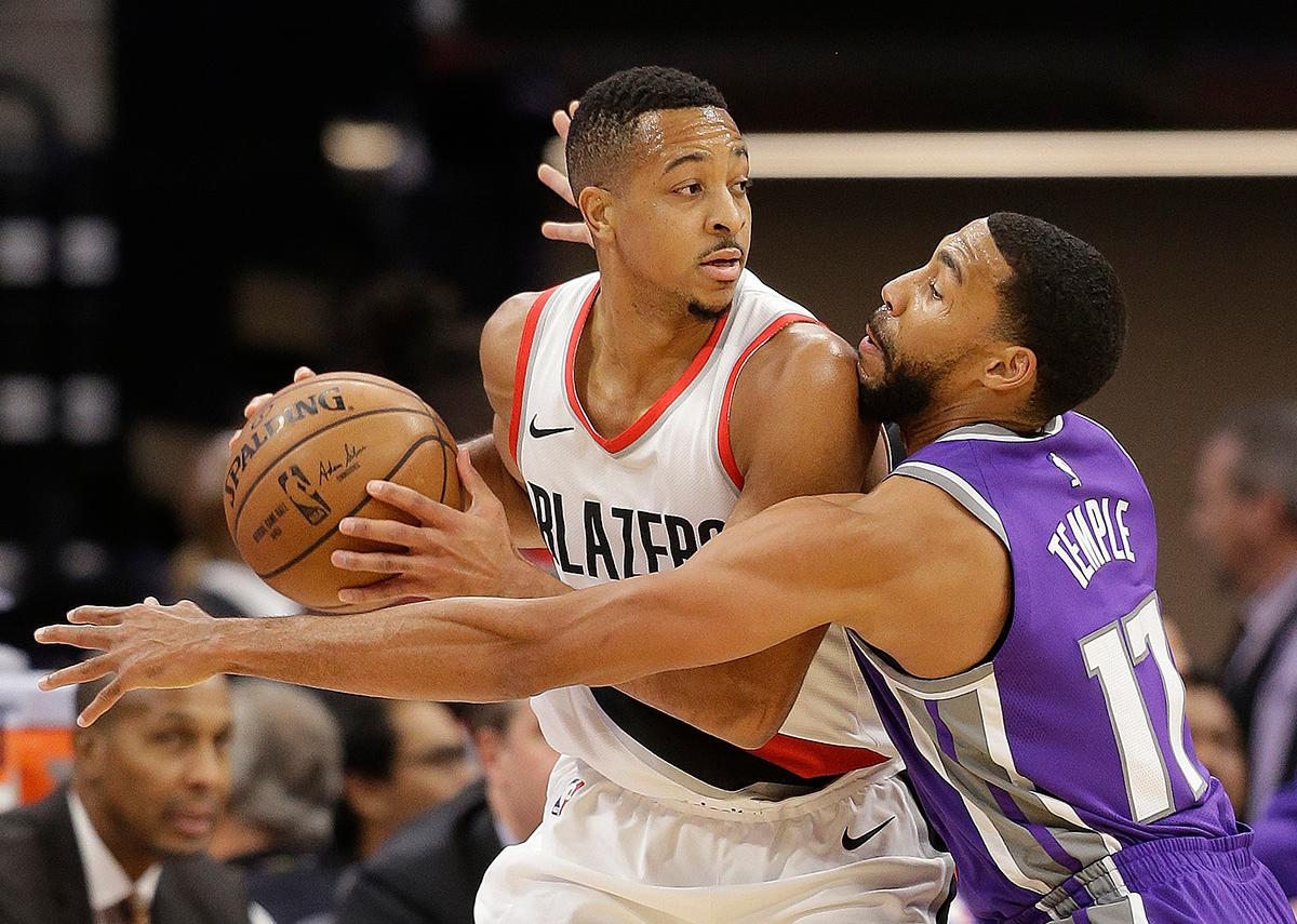 Sacramento Kings guard Garrett Temple, right, pressures Portland Trail Blazers guard CJ McCollum during the first quarter of an NBA basketball game Friday, Nov. 17, 2017, in Sacramento, Calif. (AP Photo/Rich Pedroncelli)